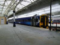 A keek ('peep' to English visitors) through a locked gate to the former Platform 2 at Aberdeen, now used for stabling. There's a foreshortened ex-Platform 1 to the left. Other southern bays 3, 4 and 5 survive and are in regular use. The northern bays once mirrored this profusion but are long gone, with through platforms 6 and 7 doing for Inverness line services. With only a single track as far as Dyce (for now?) this is all it needs.<br><br>[David Panton&nbsp;28/09/2016]