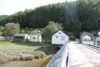 A view looking back over the wooden toll bridge at Penmaenpool to the south bank of the estuary, and the <I>bird hide</I> signal box, on 19th September 2016. The old station lies just to the right of the toll booth, which was once adjacent to a level crossing. <br><br>[Mark Bartlett&nbsp;19/09/2016]