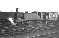 LMS 0-6-0T 16238 photographed at Balloch in the 1930s. The ex Caledonian McIntosh 3F, dating from 1895, was eventually withdrawn from Yoker shed in September 1958 as BR 56238.  <br><br>[Dougie Squance (Courtesy Bruce McCartney)&nbsp;//]