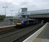 An Inverness to Glasgow service departs Perth with a honk  for trackworkers ahead. This view gives a rather misleading picture of the station which in the main is unreconstructed Victorian (and all the better for it).<br><br>[David Panton&nbsp;05/10/2016]