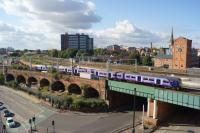 With Salford Central to the right and behind the camera, a Northern Class 319 from Manchester Victoria to Liverpool service takes the line towards Ordsall Jct on 08 October 2016. The lines to the right head towards Salford Crescent.<br><br>[John McIntyre&nbsp;08/10/2016]