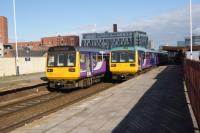 Two pairs of Pacers pass each other at Salford Central on 08 October 3016. The pair on the left are heading to Manchester Victoria just one stop away while the pair on the right are off to Southport.<br><br>[John McIntyre&nbsp;08/10/2016]