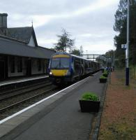 Loop Platform 2 at Dunkeld is used only to allow passing, as here when a Glasgow to Inverness service waits an Edinburgh-bound to arrive and allow it to proceed.<br><br>[David Panton&nbsp;05/10/2016]