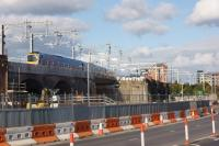 A TPE Class 185 crosses the viaduct carrying the line from Ordsall Jct to Salford Crescent on 8 October 2016. To the right of the train a line of grab bags marks the spot where the new Ordsall Chord leaves the existing line and crosses above the camera to the new junction facing Deansgate.<br><br>[John McIntyre&nbsp;08/10/2016]