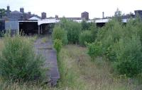 Wolverhampton Low Level, unloved and abandoned with a road driven through its east end, in 2003. But plans were afoot and the site was surrounded by security fencing on all sides.<br><br>[Ewan Crawford&nbsp;03/07/2003]
