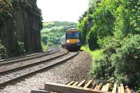 A mid morning ScotRail service bound for Cowdenbeath runs through the rock cutting shortly after leaving the Forth Bridge in June 2006. After passing the camera position the train will then cross Jamestown Viaduct [see image 9752].<br><br>[John Furnevel&nbsp;20/06/2006]