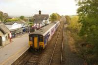 Once a junction but on a smaller scale than its southerly namesake, Clapham in North Yorkshire is rather quieter and in a more rural setting. A Northern DMU is seen departing with a Morecambe to Leeds service in October 2014.<br><br>[John McIntyre&nbsp;16/10/2014]