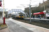 Patches of rock salt decorate the platforms of Hamilton Central on a cold and frosty March morning in 2006 as SPT-liveried 318262 passes west below Quarry Street to arrive at platform 1 with a Larkhall - Dalmuir service.<br><br>[John Furnevel&nbsp;17/03/2006]