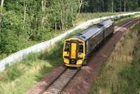 ScotRail 158730 forming the 0911 Sunday service to Tweedbank passing Arniston and running into the Gore Glen on a bright and sunny September morning in 2016.<br><br>[John Furnevel&nbsp;04/09/2016]