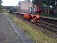 An unusual working captured on camera at Croston heading towards Preston on 16 October 2016. The Network Rail team were cutting down lineside vegetation during a T3 possession and their self propelled (although not a true RRV) shredding machine was very effective and converting plant material into a light mulch or chip.<br><br>[John McIntyre&nbsp;16/10/2016]