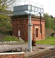 The water tower and crane at the south end of Appleby station, photographed on 6 May 2006. The facilities were installed by the local Round Table in 1991 to service the increasing number of steam specials using the Settle & Carlisle route.<br><br>[John Furnevel&nbsp;06/05/2006]