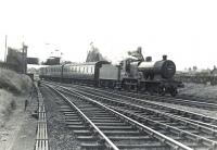 A Kilmarnock - Winton Pier train takes the left fork at Holm Junction after leaving Ardrossan South Beach station on 4 July 1959. The locomotive is one of Hurlford shed's Fowler 2P 4-4-0s no 40688, only 4 weeks from final withdrawal.  <br><br>[G H Robin collection by courtesy of the Mitchell Library, Glasgow&nbsp;04/07/1959]