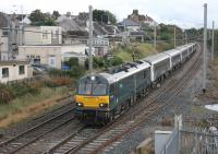A short rake of Caledonian Sleeper stock was used to take Paralympian athletes from Manchester to Euston on 18th October 2016. The ECS was then worked back to Polmadie and is seen passing Hest Bank behind GBRf electric 92010.<br><br>[Mark Bartlett&nbsp;18/10/2016]