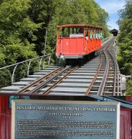 Geissbach Funicular was built in 1879 to transport guests and supplies from a steamer station on Lake Brienz 322' up to the hotel above. It was the first funicular in the world to use a single track with passing places rather than two parallel lines and as such, in 2015, the American Society of Mechanical Engineers designated it a Historic Mechanical Engineering Landmark.<br><br>[Mark Bartlett&nbsp;20/06/2016]