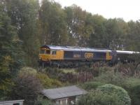 Not the most exciting photo ever taken, but a photo couldn't capture the very impressive sound of GBRf Class 66 No 66701 hammering up the line from Barassie and onto the steep gradient up to Kilmarnock station with a loaded coal train at 1438 hrs on Saturday, 22 October, 2016. These coal trains have always tended to be timed through Kilmarnock to clash with passenger services in and out of the station so the norm is for them to get amber at the distant signal down towards Moorfield and they either slow down or crawl past the old St. Marnocks signalbox site to the outer home signal further up the gradient, where they can be held for anything up to 25 minutes. Being a wee bit later on the day (the Glasgow service departs at 1430hrs) No 66701 obviously got greens all the way so the driver had applied the boot to get some momentum for the climb up to the station.<br><br>[Robert Blane&nbsp;22/10/2016]