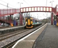 Platform view east at Curriehill station on a cold March morning in 2006 as ScotRail 156450 calls with a Glasgow Central - Edinburgh Waverley via Shotts service. <br><br>[John Furnevel&nbsp;07/03/2006]