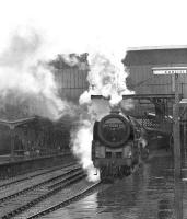 Britannia Pacific 70003 with a northbound train on a wet day at Carlisle in the 1960s.