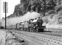 A pair of LMS 4-4-0s double heading the up <I>Mid-Day Scot</I> through Galashiels in the 1930s. The diversion had resulted from an accident on the West Coast Main Line near Carstairs.