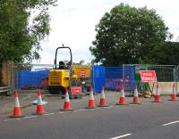 Somewhat unusually, the Biggar Road overbridge at Cleland station is being kept open for pedestrians during work to replace the papapets and deck prior to electrification of the Shotts line.