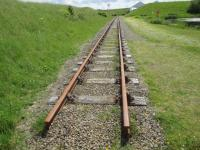 A section of remaining (or re-laid) track at the former Lyness Submarine Base in Orkney.