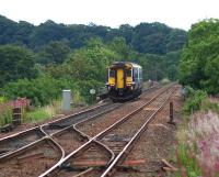 A clear pre-electrification view from Cleland station as 156462 on a limited stop service from Glasgow Central to Edinburgh via Shotts crosses the Cleland Viaduct. Vegetation clearance has been carried out and work to modify and replace overbridges is in progress (August 2016).