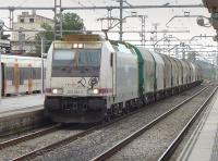 Renfe 253 064-0 passes Sant Vincenc de Calders with a southbound steel train on 14 October.<br><br>[Bill Roberton&nbsp;14/10/2016]