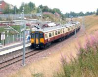 SPT liveried 318251 arrives at Merryton, the first stop out from Larkhall terminus, on 18 August 2006 with a train for Dalmuir. Merryton is essentially a large housing development on the northern edge of the Lanarkshire town, with the stations just over half a mile apart. <br><br>[John Furnevel&nbsp;18/08/2006]
