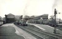 The east end of Paisley Gilmour Street on Saturday 24 September 1949, with Glasgow bound trains at the platforms. Fowler 2-6-4T 42421 is ex-Gourock, while Fairburn 2-6-4T 2195 has arrived with a train from Ayr.<br><br>[G H Robin collection by courtesy of the Mitchell Library, Glasgow&nbsp;24/09/1949]