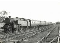 The empty stock of a Glasgow Central - Uplawmoor train at Lugton East sidings on 15 June 1961. Locomotive is Polmadie shed's Fairburn 2-6-4 tank 42055.    <br><br>[G H Robin collection by courtesy of the Mitchell Library, Glasgow&nbsp;15/06/1961]