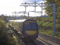 The wiring on the north end of the Cowlairs Incline looks almost complete as the 1306 arrival from Edinburgh descends in the afternoon sunshine on 5th November 2016. However, the supports cease before the Pinkston Road overbridge and there's no knitting yet for some distance up the hill from there.<br><br>[Colin McDonald&nbsp;05/11/2016]