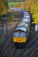 The Inverness - Mossend intermodal, diverted through Fife because of engineering work in the Stirling area, passes Inverkeithing Central Junction, behind DRS 66423, on 30 October.<br><br>[Bill Roberton 30/10/2016]