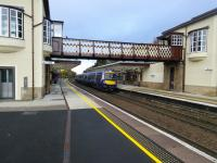 A Glasgow-bound service calls at the immaculate Gleneagles station on 26/10/2016. Gleneagles shows that a station doesn't have to be staffed to look good. Incidentally Gleneagles doesn't exist according to the BBC weather app so as you can see it has no weather.<br><br>[David Panton&nbsp;26/10/2016]