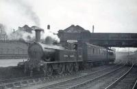 Ex-LNWR Webb 2-4-2T 46635 at Dumfries shortly after sunrise on 18 April 1949 with the Lockerbie push-pull train. The 1892 veteran was finally withdrawn in April 1950 from Dumfries shed, the roof of which can be seen above St Mary's Street road bridge in the background.  <br><br>[G H Robin collection by courtesy of the Mitchell Library, Glasgow&nbsp;18/04/1949]