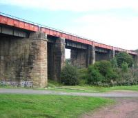 The mighty plate-girder viaduct that once carried the R&C extension over the Monkland Canal just to the east of Calder station between Whifflet and Airdrie. Photographed looking east in August 2006, the structure is now part of a walkway/cycleway.<br><br>[John Furnevel&nbsp;02/08/2006]