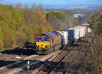DB Cargo 66102 takes the Cumbernauld line at Greenhill Lower Junction with a Grangemouth - Mossend intermodal trip on 7 November. Not the concrete base prepared off to the left.<br><br>[Bill Roberton&nbsp;07/11/2016]