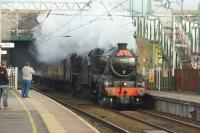 Ian Riley's LMS Black 5s nos. 44871 and 45407 make an impressive sight as they pass Euxton Balshaw Lane station whilst working 'The Tin Bath' railtour from Preston to Sheffield on 06 November 2016.<br><br>[John McIntyre&nbsp;06/11/2016]