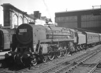 An unidentified Britannia Pacific, nameplate removed, stands with a train alongside platform 4 at Carlisle. The photograph is thought to have ben taken on 2 July 1966.<br><br>[K A Gray&nbsp;02/07/1966]