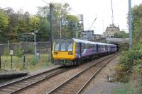 A 153/142 combination leaves Shipley on a Leeds to Morecambe service on 21st October 2016. Behind the Pacer the south to north chord, used by Forster Square to Skipton services, trails in from the left at Shipley (Bingley Junction). [See image 38118] for a view of this much changed location in 1974.  <br><br>[Mark Bartlett&nbsp;21/10/2016]
