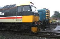 Preserved locomotives 47643 and 08443 stand in pouring rain in the yard at Bo'ness on 6 September 2006. <br><br>[John Furnevel&nbsp;06/09/2006]