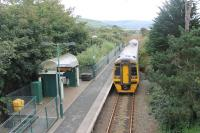 ATW 158832 pulls away from the halt at Talybont with a Pwilhelli to Birmingham International service. This view looks south towards the next minor halt at Llanaber with Barmouth and the Mawddach estuary beyond.  <br><br>[Mark Bartlett&nbsp;19/09/2016]