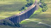 Class 158 passes over Ribblehead Viaduct in 2015.<br><br>[Ian Dinmore&nbsp;15/07/2015]