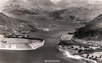 View over Ballachulish Ferry and up Loch Leven. The ferry is midway across to North Ballachulish and the railway can be seen on the right running to Ballachulish. The Ballachulish Bridge would now dominate this picture.<br><br>[Ewan Crawford Collection&nbsp;//]