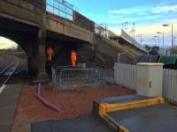 Preparatory work for the replacement overbridge at the south end of the Station Road bridge on 17th November 2016. The stairs and part of the access ramp have been removed and work continues above to relocate services on to the temporary pedestrian bridge [see image 56590].<br><br>[Colin McDonald&nbsp;17/11/2016]