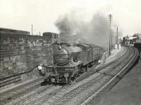 V3 67679 brings a Bridgeton Central - Drumry train off the branch at Bridgeton Central Junction, just east of High Street station, on 10 July 1957.   <br><br>[G H Robin collection by courtesy of the Mitchell Library, Glasgow&nbsp;10/07/1957]