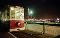 Diesel tram parked at the Theatre end of the short pier tramway (1991 - 2004) with a notable tower in the backdrop. <br><br>[Ewan Crawford //2001]