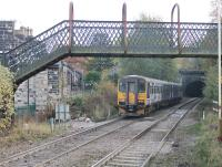 Leyland Sprinter 155343 pulls away from a stop at Walsden (new) station heading towards Manchester on 31st October 2016. The original Walsden station, closed in 1961, lay between the footbridge and Winterbutlee Tunnel with a level crossing in the foreground. <br><br>[Mark Bartlett&nbsp;31/10/2016]
