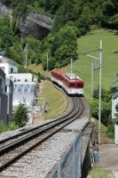 Rigi Bahn cars 22 and 32 leave the lakeside town of Vitznau and immediately begin the steep ascent of the Rigi mountain on 27th June 2016. <br><br>[Mark Bartlett&nbsp;27/06/2016]