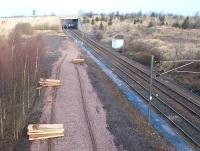 Track and sleepers ready to form a new turnback siding at the north end of Millerhill yard on 28 January 2002. The work was in preparation for the introduction of train services to the new station at Newcraighall,  at that time under construction just beyond the bridge. The new services commenced some 4 months later [see image 3430].<br><br>[John Furnevel&nbsp;28/01/2002]