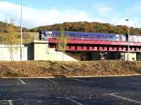 Approaching Galashiels from the south on 10 November 2016, the 1128 ex-Tweedbank crosses Currie Road bridge. Photographed looking north east from what must be the quietest car park in Gala. <br><br>[John Furnevel&nbsp;10/11/2016]