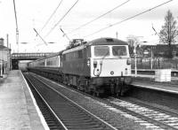 87020 <I>North Briton</I> heads a passenger service south through Leyland on 3rd December 1980. Rather unusually the train is on the Up Slow line. 87020 continued in BR/Virgin service until 2009 and has since been exported to Bulgaria. <br><br>[Mark Bartlett&nbsp;03/12/1980]